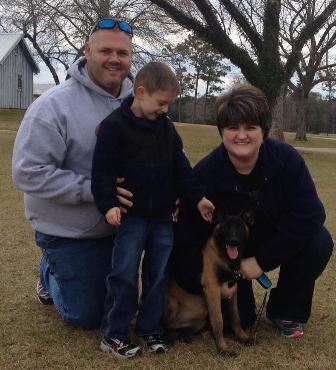 the Hebert family and their psd puppy Dixie